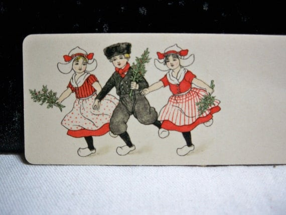 Sweet 1920's place card Christmas theme dutch children 2 girls and boy dressed up holding holly berry
