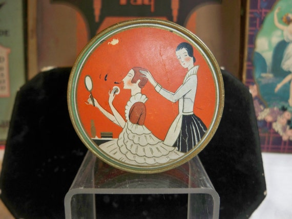 1920s Art Deco Richard Hudnut Three Flowers Face powder box lady applying powder and hair done by by maid