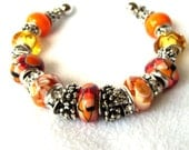 Beautiful Shades of Orange, Mustard and Red European Beaded Cuff Bracelet