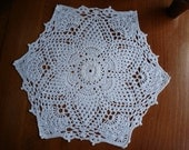 New twelve inch crochet doily in white.