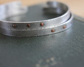 single sterling silver cuff bracelet with copper rivets--textured, delicate, fierce