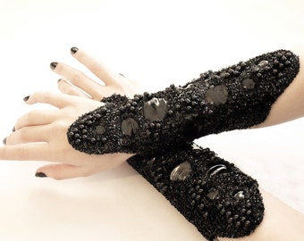 Black PVC beaded, embroidered Cuffs Gauntlets laced up with eyelets.