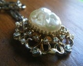Gold tone vintage intricate pearl and rhinestone pendant