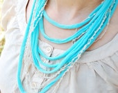 T shirt necklace - layers of teal material with yarn details