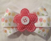Pink fabric puffy flower with white button center and satin flower ribbon hair bow (CGA)