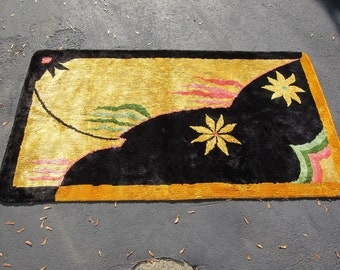 Wow bright vintage rug from the 1930's.