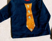personalized child's long-sleeved t-shirt or onesie with an appliqued tie