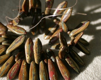 4x15mm . Czech Pressed Glass Daggers brown ceramic with bits of yellow, red, blue . 15 beads