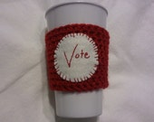Vote red coffee cozy, crochet acrylic yarn with wool felt applique, hand embroidered