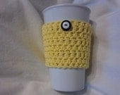 yellow cotton coffee cozy, cotton with stacked black and white buttons