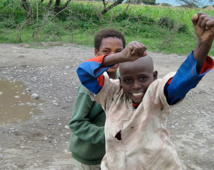 A Boy's Excitement, International Travel, Africa, Village Boys, Red Road, Ethiopia 8x10 Rural Travel Photograph