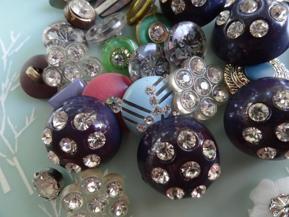 Lots of Shine from a Lot of Shiny Buttons, all size and shapes.   Stunning.