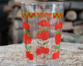 Vintage glass measuring cup with red and green fruit print made in Reims, France