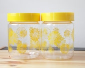 Vintage Daisies Glass Canisters with Air Tight Yellow Tops by Corningware Set of 2 Circa 1960s