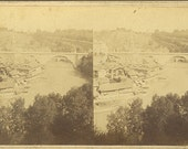 Stereograph.  View of unidentified, large town, river and bridge, Switzerland, by Adolph Braun ca. 1865.