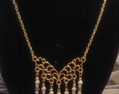 Beaded necklace on chandelier pendant