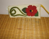 Felted zip topped clutch embellished with felted flowers, leaves and stems.
