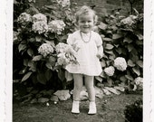 happy young child with flowers  - vintage photo