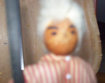 Gun totting Grandpa Hickory Nut Doll, The Doll is Wood the head is a Hickory nut...