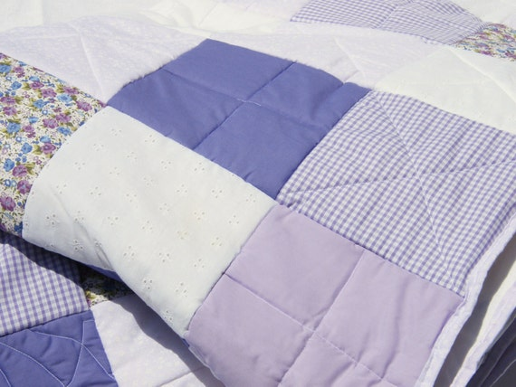 Handmade Purple/lilac/mauve/white/floral Patchwork Quilt. With stitching detail and random pattern design. (to fit single or double bed.)