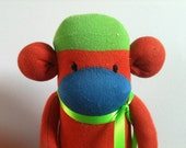 SALE Pumpkin the large orange, blue, and bright green sock monkey doll, with bright green ribbon