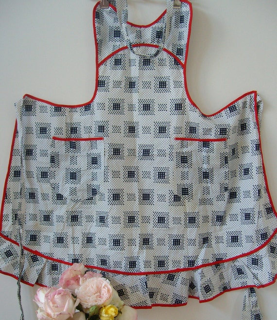 Vintage apron, full red white and navy polka dots geometric print red piping, excellent condition, ties at waist, bib style top, cotton