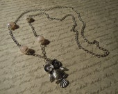 Beautiful handmade silver victorian Owl necklace with rose Quartz beads