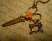 Beautiful seamstress necklace scissors with singer sewing machine and orange cabochon