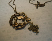 Victorian bronze Alice in Wonderland Necklace handmade by Gloriously Created Gifts