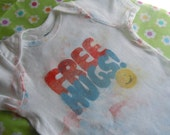 One of a kind Free Hugs onesie size 24 months very vintage looking