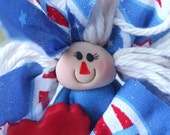 Polymer clay rag doll in red white and blue