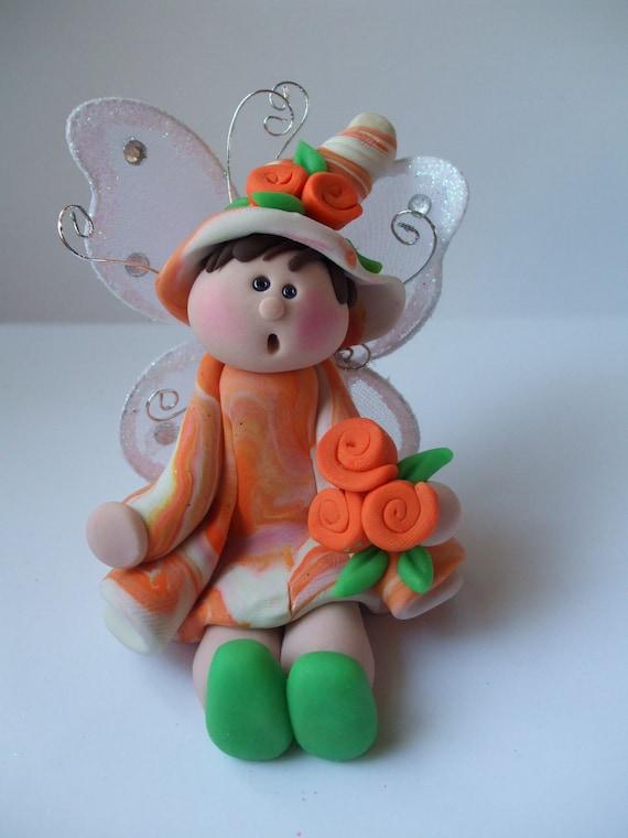 Handmade fairy polymer clay orange and green