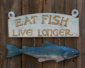 Eat Fish Live Longer hanging sign