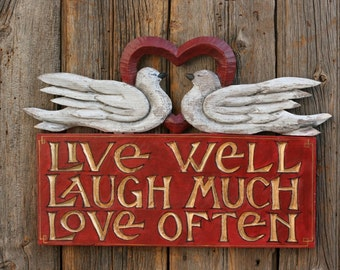 Live Well, Laugh Much, Love Often sign with Doves and open heart