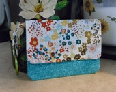 Wristlet Wallet Perfect for traveling, hiking and much more. Fits in Tekhno bags. Teal and pretty fall floral material.