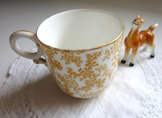 Charming Vintage Demitasse Cup with Caramel Colored Pattern and Gold Rim