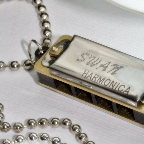 Harmonica Necklace: Mini Harmonica Necklace. PLAYS. Love Of Music And Fun. Blues