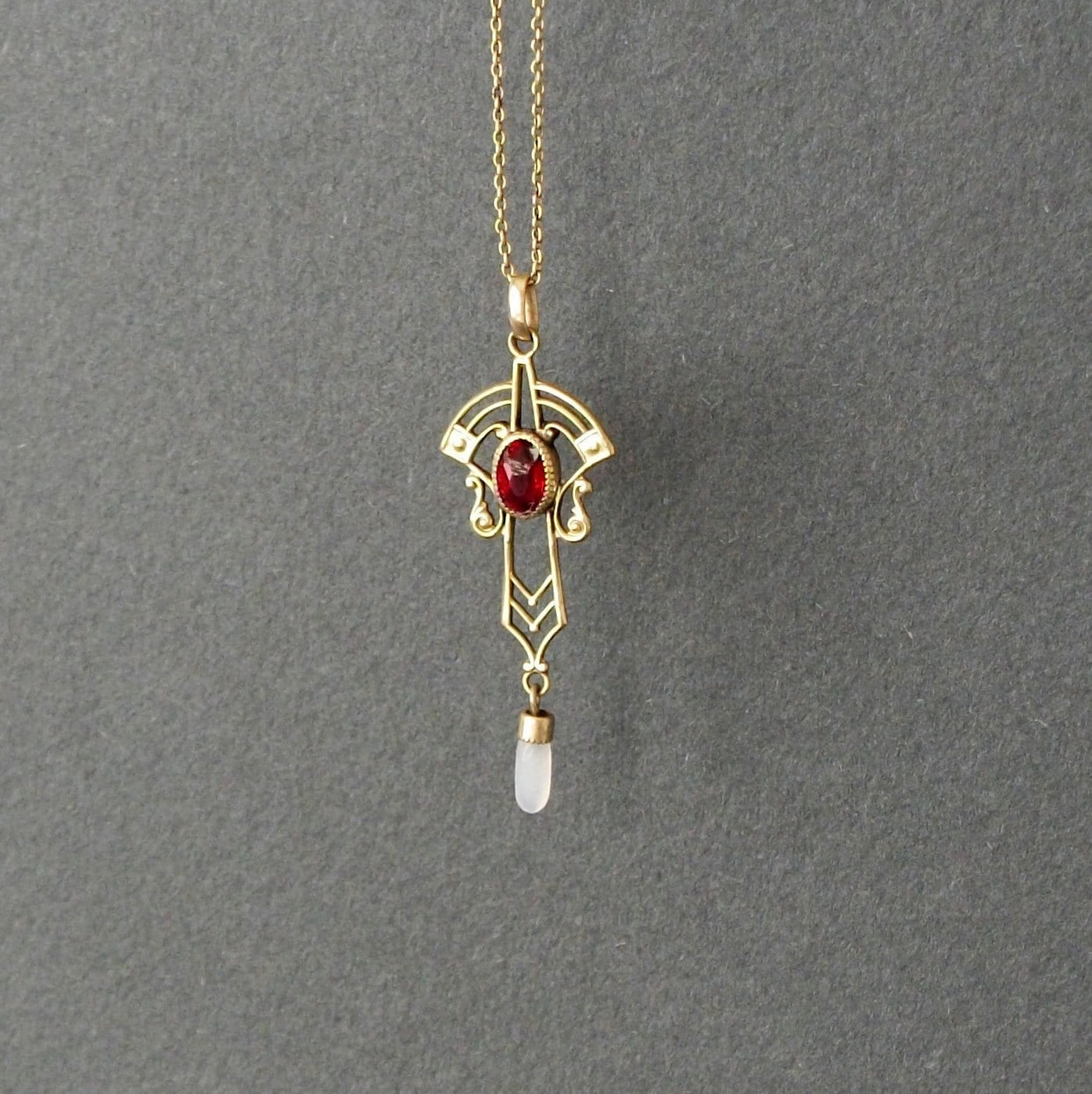 Antique Victorian Lavalier Necklace . Ruby Red Stone . Gold