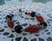 Red Oval with Black and White Swirl Lines Glass Beads & Chunky textured Jet Black Beaded Bracelet: Red Blown Glass Beauty