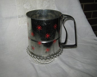 Vintage Androck flour sifter with atomic red stars