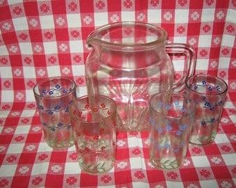 Vintage glass pitcher with four Swanky Swigs