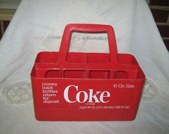 Coca Cola plastic bottle carrier