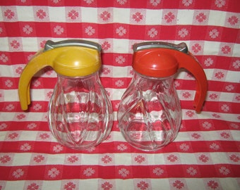Glass syrup pitchers red plastic and butterscotch lids