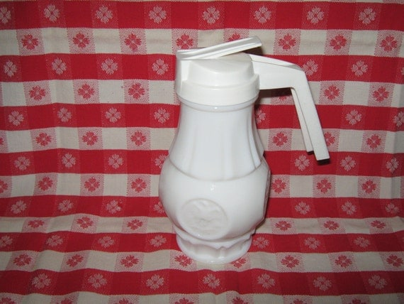 Milkglass syrup pitcher with eagle imprinted around bottom