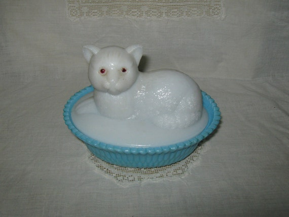 Milk glass cat on blue dish
