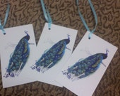 peacock tags, applique..Qty 100