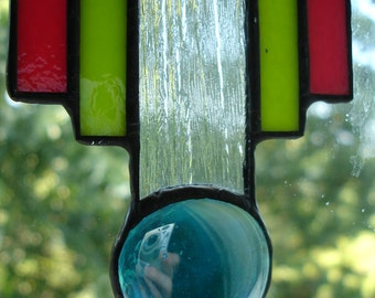 Deco suncatcher with lime green, orange, clear and red glass