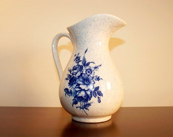 vintage ivory pitcher with blue flower bouquet