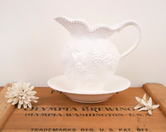 vintage ivory pitcher with plate