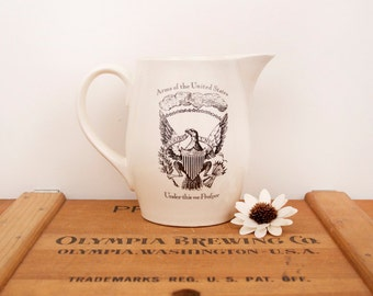 vintage ivory pitcher with American coat of arms images